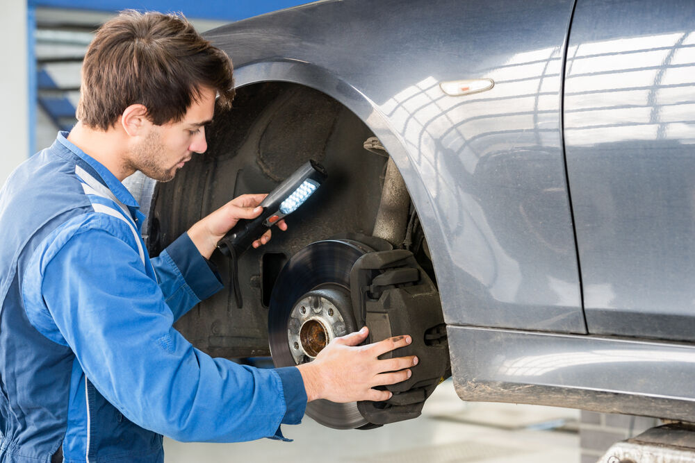 Man Checking Breaks - South Bay Car Care -July 28 blog