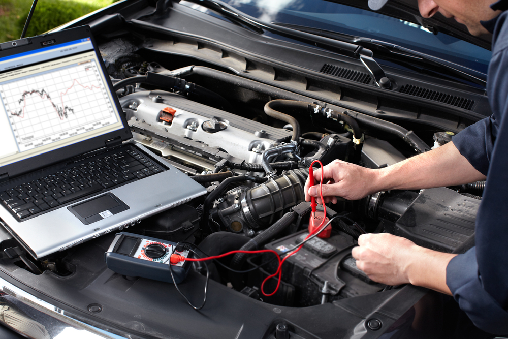 Auto Mechanic Running a Diagnostic on Engine